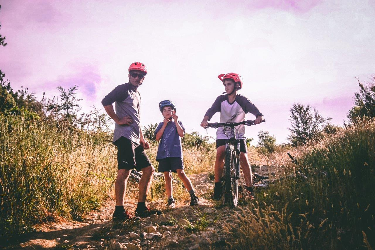 dad with 2 kids all on mountain bikes