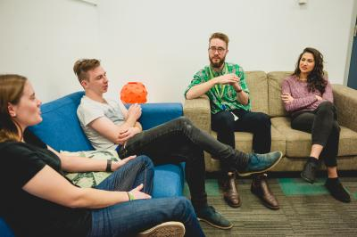 Four people sat on sofas engaging in a group session at a headspace centre